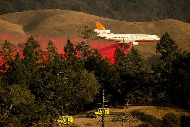 An air tanker drops retardant while battling the Kincade Fire in unincorporated Sonoma County, California