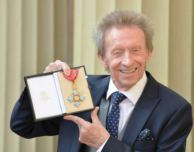 Denis Law with his CBE medal