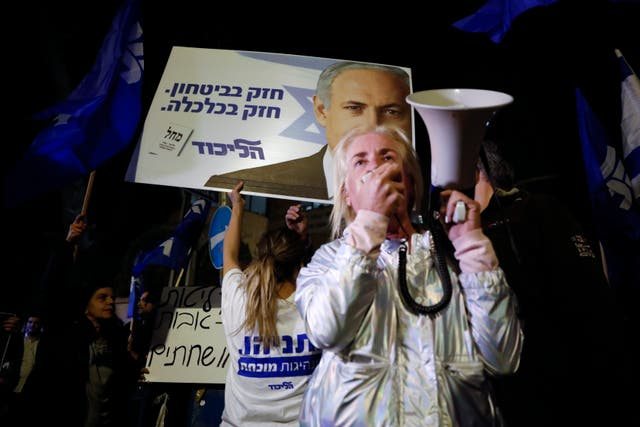 Supporters of Mr Netanyahu gather outside his residence in Jerusalem