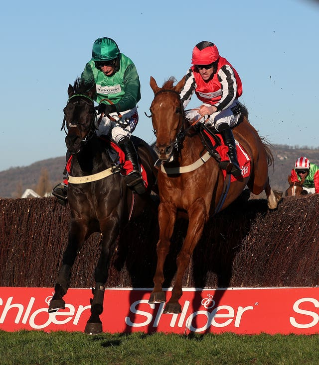 Simply Ned (right) ridden by Brian Hughes in the Shloer Chase during the November Meeting at Cheltenham