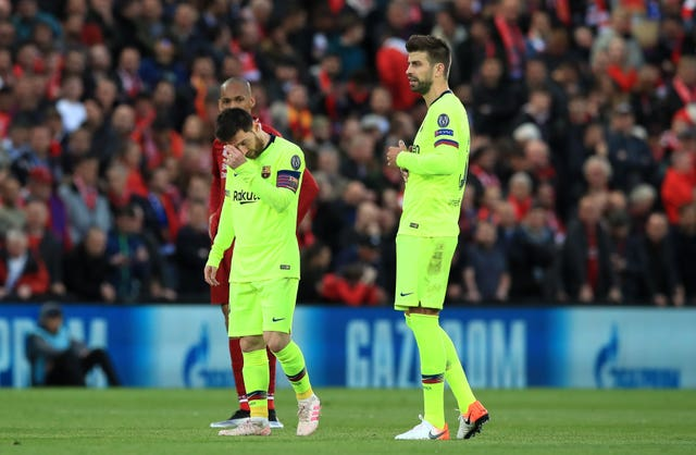 Lionel Messi (left) and his team endured a night to forget at Anfield (PA)