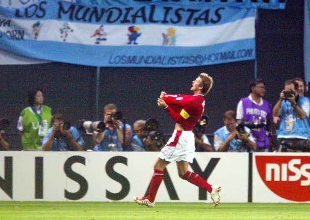 England captain David Beckham celebrates scoring against Argentina