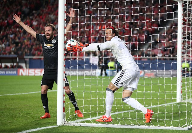 Benfica goalkeeper Mile Svilar concedes a goal against Manchester United in the Champions League
