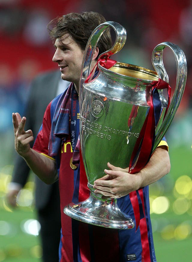Lionel Messi with the Champions League trophy in 2011