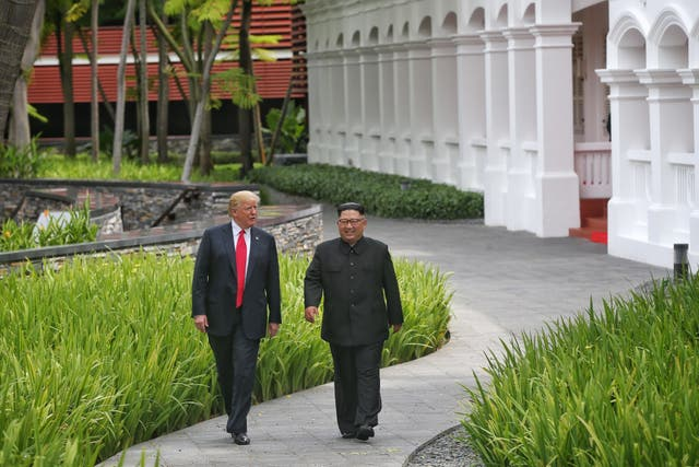 Donald Trump and Kim Jong Un (Kevin Lim/The Straits Times/PA)