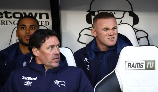 Wayne Rooney was in the dugout for the first time at derby ahead of his player-coach role