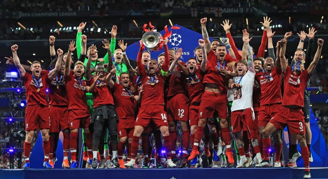 Liverpool's Jordan Henderson lifts the trophy with his team-mates after winning the Champions League in 2019