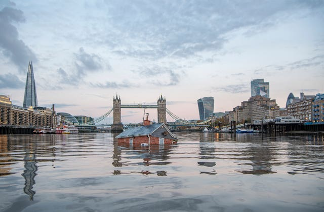 The Sinking House on the Thames next to Tower Bridge