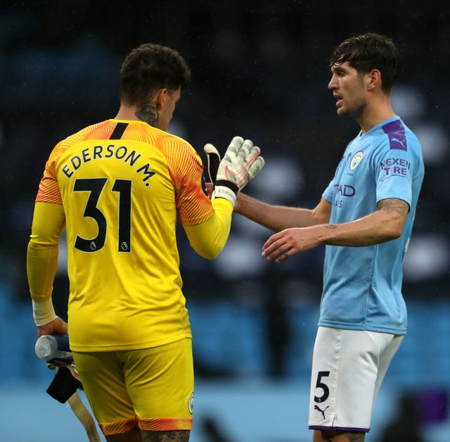John Stones (right) returned from injury in City's defeat of Newcastle on Wednesday