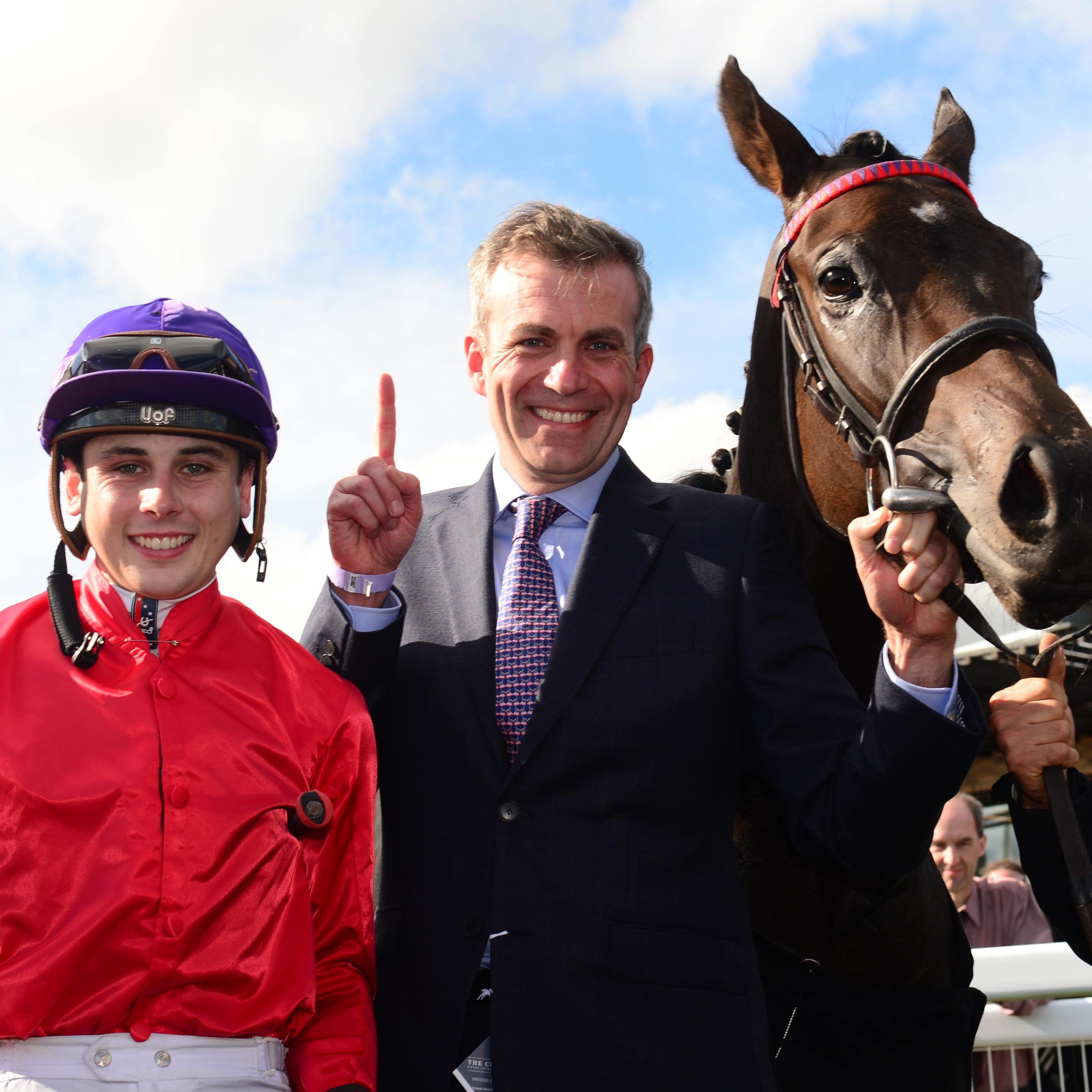 Ronan Whelan and Patrick Prendergast celebrate victory at the Curragh with Skitter Scatter