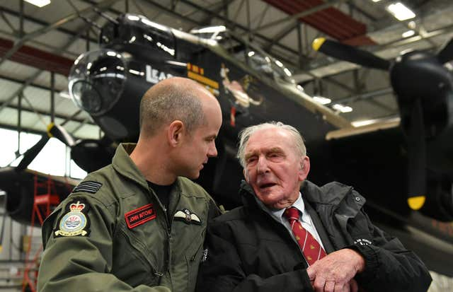 Commanding officer of 617 squadron, Wing Commander John Butcher with Johnny Johnson, the last survivor of the original Dambusters (Joe Giddens/PA)