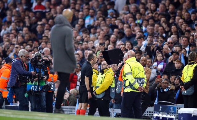 Guardiola looks on as Cuneyt Cakir checks the video