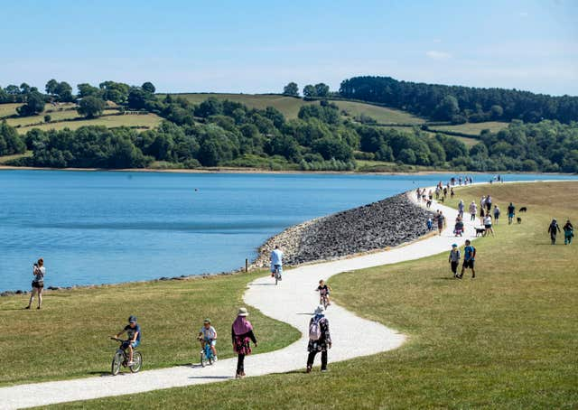 People walking in the sunshine at Carsington Water in Derbyshire