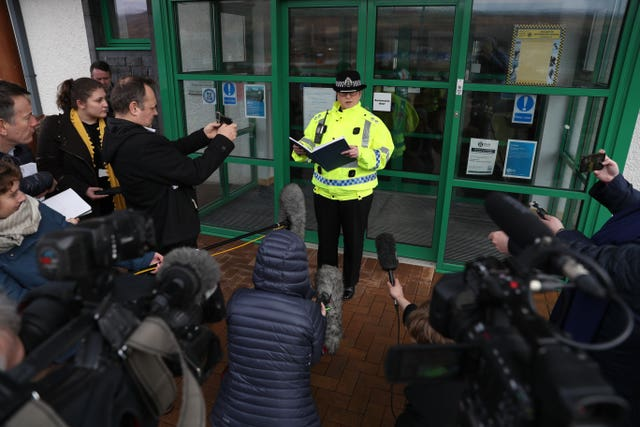 A police officer talks to media following a fatal avalanche