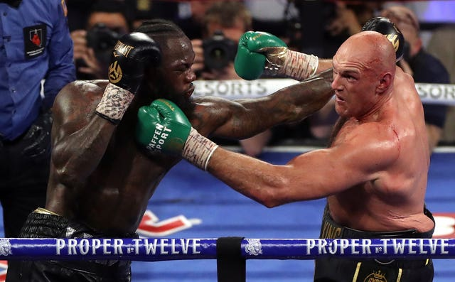 Tyson Fury (right) beat Deontay Wilder to claim the WBC heavyweight title.