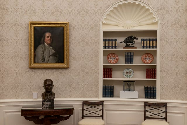 The Oval Office of the White House is newly redecorated for the first day of President Joe Biden's administration, Wednesday in Washington. On the the table is a bust of former President Harry Truman
