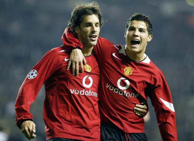 Ruud Van Nistelrooy, left, celebrates a Champions League goal with Cristiano Ronaldo