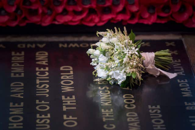 The Duchess of Sussex followed royal tradition and left her wedding bouquet on the Unknown Warrior's tomb