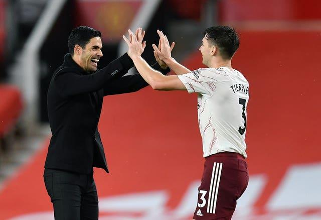 Mikel Arteta celebrates with Kieran Tierney