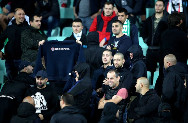 A Bulgaria fan holds up a 'No respect' slogan