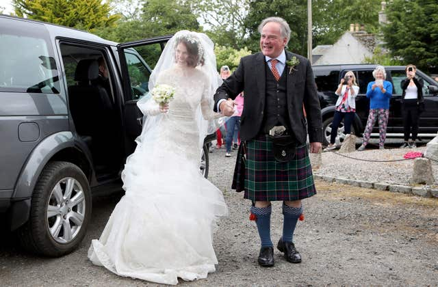 Rose Leslie and her father Sebastian Leslie arrive at the church for the wedding (Jane Barlow/PA)