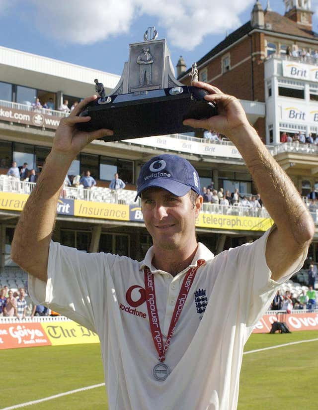 Former England captain holds aloft the Wisden Trophy in 2004.