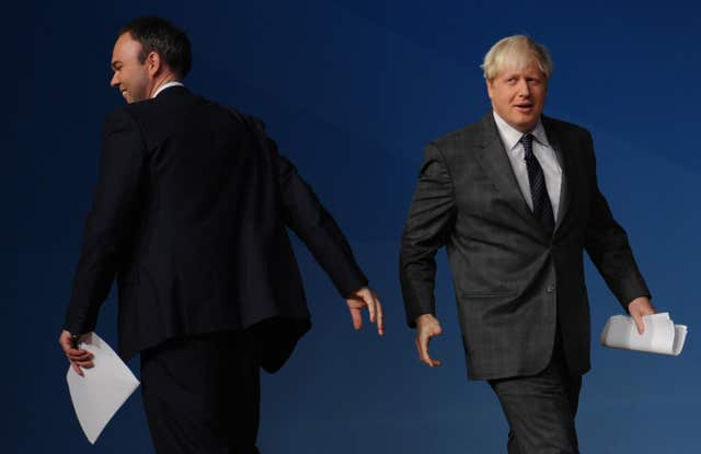 Gavin Barwell (left) and Boris Johnson (right) at the Conservative Party Conference. (Stefan Rousseau/PA)