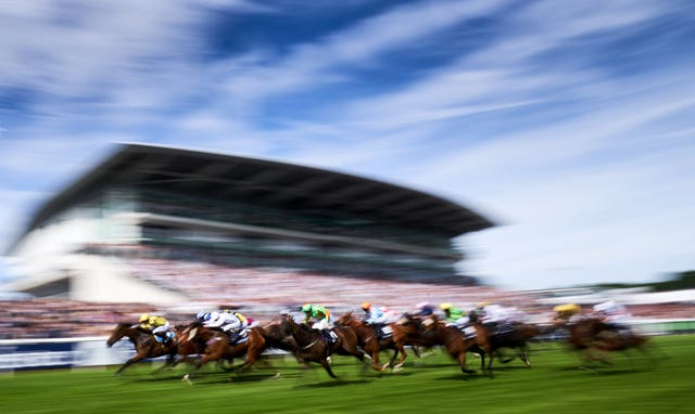 Ornate, ridden by jockey Phil Dennis, on the way to winning the Investec Dash Handicap during Derby Day at Epsom. The David Griffiths-trained six-year-old, left, made virtually every yard of the running to claim a surprise victory by a neck