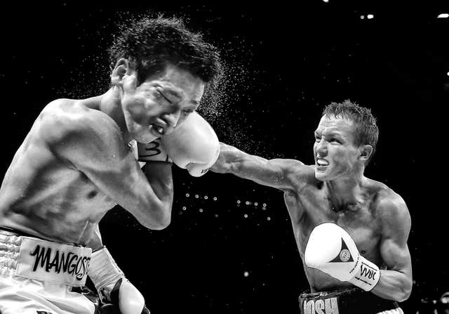Josh Warrington lands a heavy blow on Hisashi Amagasa in April 2016. Englishman Warrington retained his WBC International featherweight title with victory over the Japanese fighter in Leeds. after being awarded a unanimous points decision