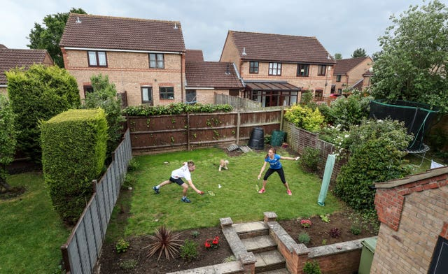 British badminton players Lauren Smith and Marcus Ellis practise in the back garden of their Milton Keynes home. The couple, who won silver in the mixed doubles at the 2018 Commonwealth Games in Australia, were forced to improvise in order to keep in shape during lockdown.