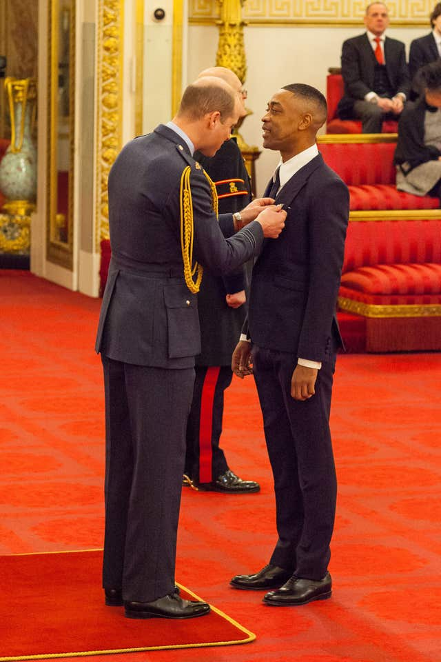 Richard Cowie, aka Wiley, is made an MBE by Prince William (Dominic Lipinski/PA)