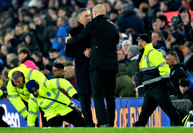 Ancelotti shakes hands with Burnley manager Sean Dyche at full-time