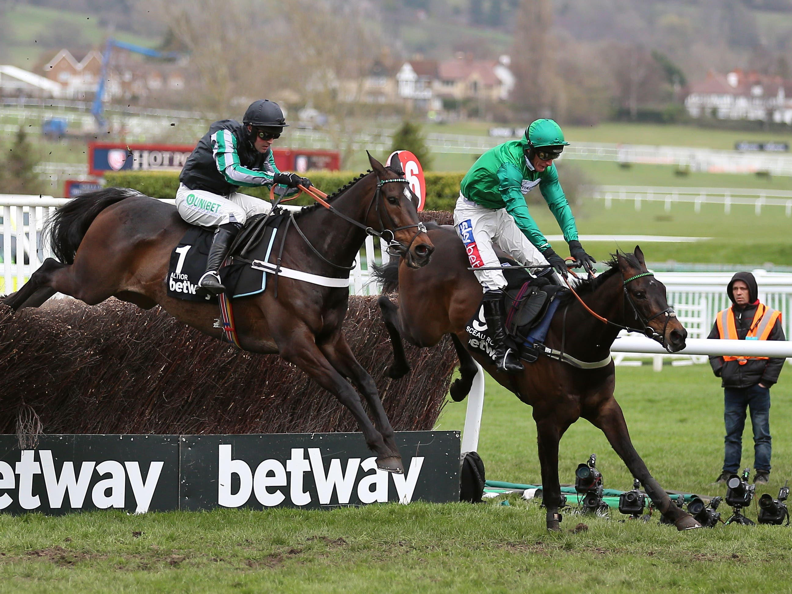 Altior and Nico de Boinville (left) had a fight on their hands on the way to a second successive Betway Queen Mother Champion Chase success (Nigel French/PA)