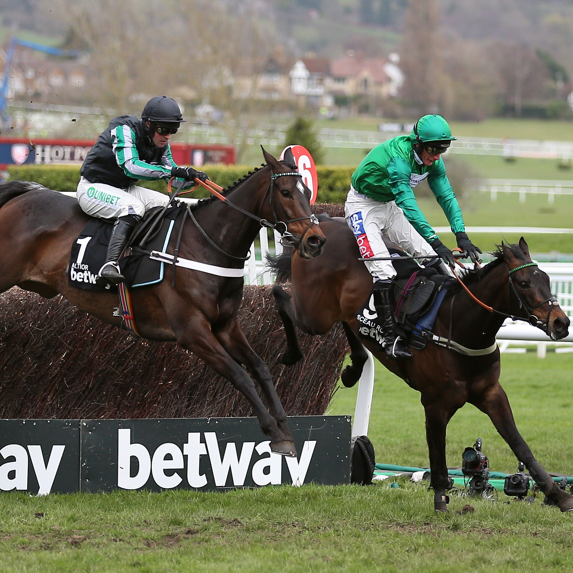 Altior and Nico de Boinville (left) had a fight on their hands on the way to a second successive Betway Queen Mother Champion Chase success