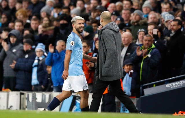 Manchester City's Sergio Aguero shares a joke with manager Pep Guardiola