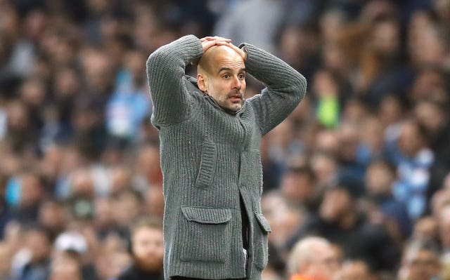 Manchester City manager Pep Guardiola reacts after Raheem Sterling's late goal is ruled out