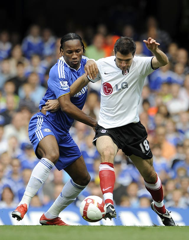 Drogba and Hughes battle for the ball during their playing days