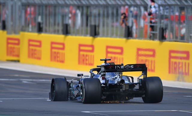 Lewis Hamilton crossed the line on three wheels following his puncture (PA Wire)