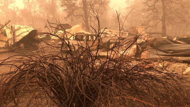 Diminishing winds and rising humidity helped firefighters battling deadly blazes in Oregon and California
