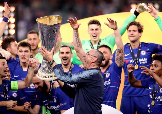 Maurizio Sarri celebrates with the Europa League trophy (PA)