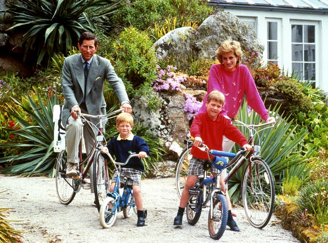 The Prince and Princess of Wales with sons William Harry on cycling trip in Tresco in 1989 (PA)