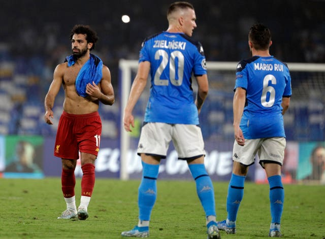 Liverpool's Mohamed Salah, left, leaves the pitch
