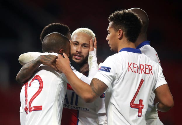 Neymar (centre) is congratulated by team-mates after scoring PSG's third goal