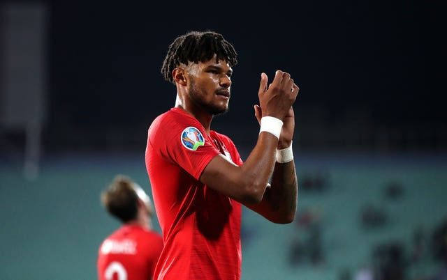 Tyrone Mings applauds England's fans at full-time