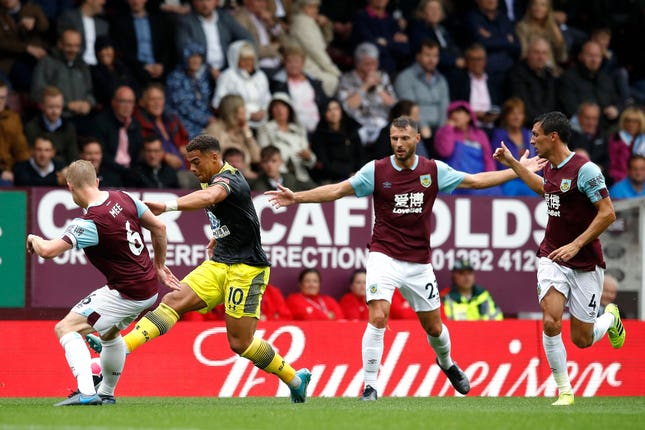 Che Adams, second left, challenges Burnley's Ben Mee