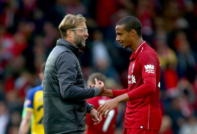 Jurgen Klopp could welcome back Joel Matip, right, at the weekend