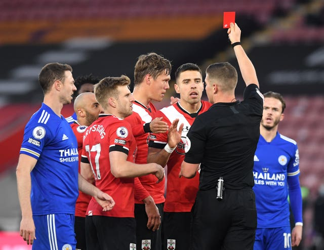 Southampton's Jannik Vestergaard (centre) is shown the red card