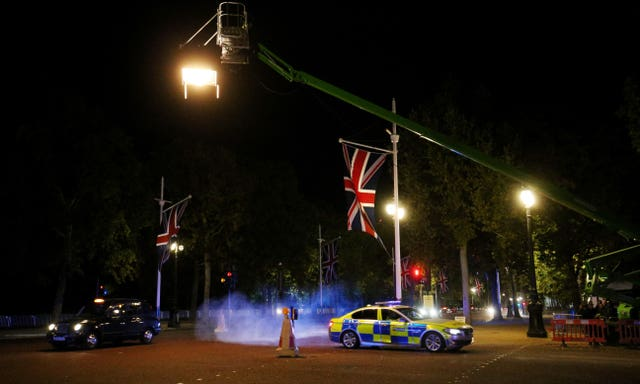 A police car is used for a chase sequence during the filming for the latest movie in the Fast and Furious franchise in The Mall, central London