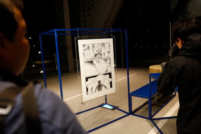 A poster created by artist Naoki Urasawa, one of 20 posters officially selected for the Tokyo Olympics and Paralympics, on display at the Museum of Contemporary Art Tokyo