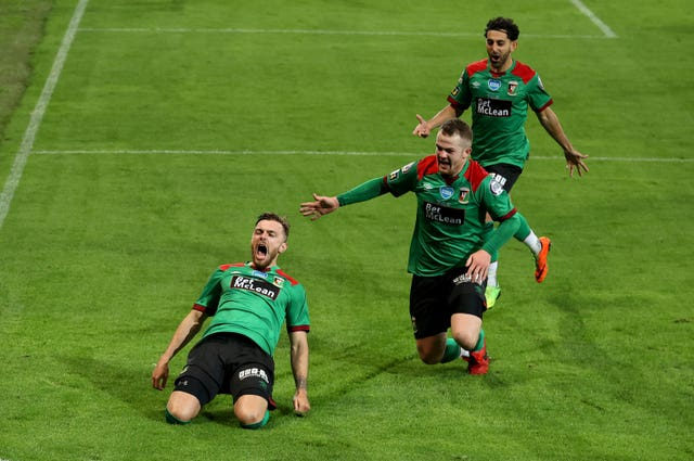 Robbie McDaid, left, was the match-winner at Windsor Park